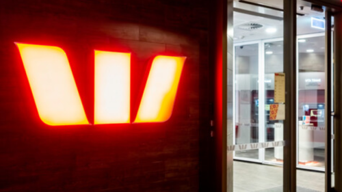 Outside of Westpac Canberra Centre branch showing a large neon Wespac logo.